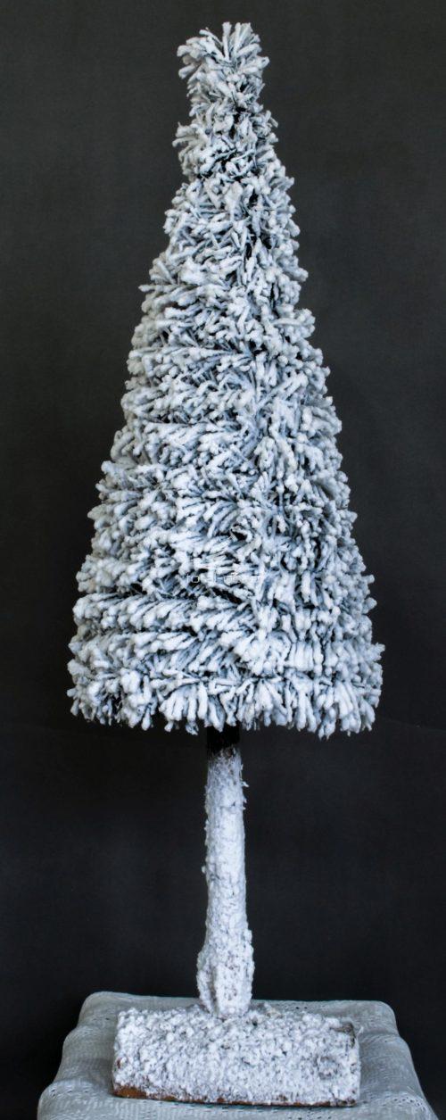 Biała choinka na pniu śnieżona oprószona śniegiem nowoczesna dekoracja bożonarodzeniowa świateczna oryginalna ozdoba