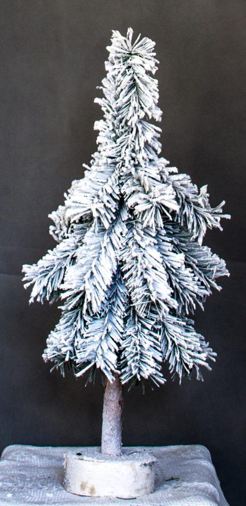 mała choinka sztuczna na pniu nowoczesna biała ośnieżona dekoracja świąteczna zimowa aura świą klimat bożego narodzenia